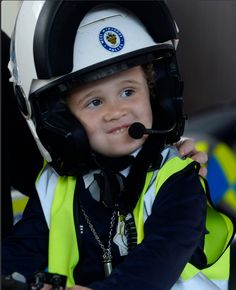 Four year old Persian on a police bike on his wish - when he became a policeman for a day! http://www.make-a-wish.org.uk/wishes/stories/persians-policeman-experience #pretend #children #film #kids #imagination #policeman #cute #dressup #makeawish #motorbike #littleboy