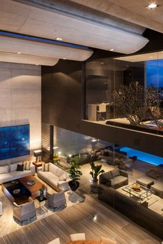 CH House ~ living room by GLR Arquitectos.