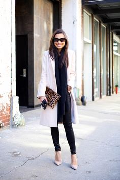 Light pink coat with black skinny jeans.