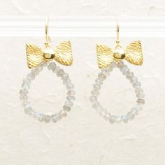"""These dazzling 18-karat gold vermeil bow earrings sparkle with faceted labradorite beads. 1 3/4"""" long. $186"""
