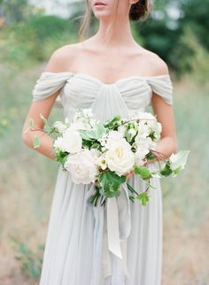 Draped off-the-shoulder Grecian wedding dress: www.stylemepretty... | Photography: Vasia - www.vasia-wedding...