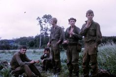 "Australian soldiers of 3rd Battalion, Royal ""Bob Wood: From l to r, Pricey RIP, Butch Collins sitting, Moe McCowan, Foxy and Marra - 7 Platoon, Charlie Company, 1971, Phuoc Tuy Province."" ~ Vietnam War"