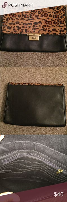 Leopard pattern leather clutch Leather clutch by fossil. Too cute but I don't have as many events to show this off. Fossil Bags Clutches & Wristlets
