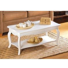 With clean graceful curves and a soft white finish, this #Classic #CoffeeTable is #Simplicity itself. A room-brightening #Accent that adds #CottageStyle #Romance to any surrounding!