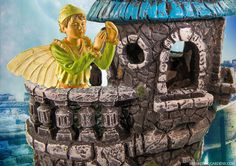 A little fairy in our castle fairy house in the fairy garden.