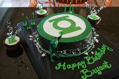 My Nephew wanted a Green Lantern cake for his 6th birthday. This is what I came up with...  The Front  The Back  The Cupcakes  Using 1 box o...