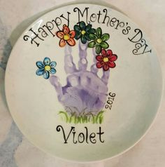 Happy mother's day plate. Handprint flowers.