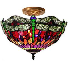 Make a room feel taller with this Tiffany-style dragonfly lamp. It mounts on the ceiling, drawing the eye upward and highlighting crown molding or other architectural details. Designed to accept two 4