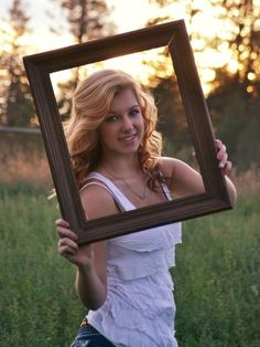 Senior picture with picture frame Senior picture ideas