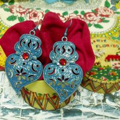 Portuguese folk jewelry Hearts of Viana style Blue dangle earrings with Red rhinestones. It is my modern version of Portugal traditional lacy hearts jewelry.$39.00...#portugalearrings#madeinportugal#portuguesejewelry#filigreehearts#vianaheart#portuguesefolkart