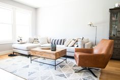 Kelly is still searching for an inspiring piece of art above Four Hands' Grammercy 2 Piece Sectional. The Lucas Leather Swivel Chair is from West Elm. The coffee table is also from West Elm, and features hidden storage.