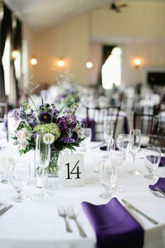 Purple and green wedding centerpieces. From Matt & Kristen's simple, rustic fall wedding in Virginia. Images by Meghan Hale Photography.