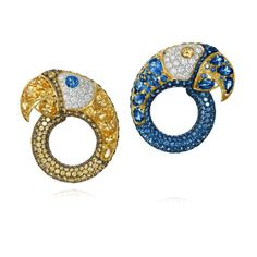 These colourful Arara parrot earrings by Amsterdam Sauer are set with diamonds and yellow and blue sapphires.