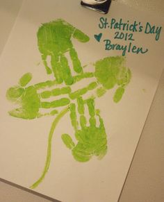 Toddler shamrock handprint art for St. Patrick's day!