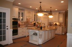 antique white with brown glaze with large corbels on island coners
