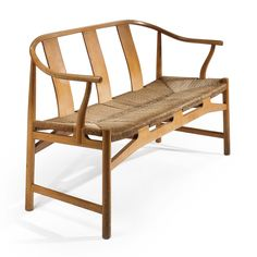Hans Wegner CHINESE SETTEE with stamped manufacturer's mark teak and paper cord 31 1/4 x 51 1/8 x 18 3/4 in. (79.4 x 129.9 x 47.6 cm) ca. 1945 manufactured by Fritz Hansen, Denmark
