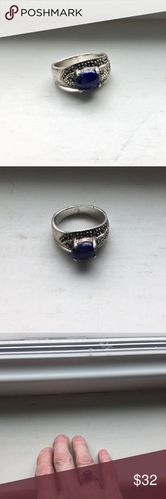 beautiful silver and lapis stone ring Very pretty- not stamped silver but purchased at a bazaar in Spain as silver so pretty sure it is- decorative border, approx size 6 1/2 Jewelry Rings
