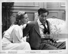 Rita Johnson And Ray Milland sit on sofa in a scene from the film 'The Big Clock', 1947.