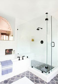 black floor tiles, white wall tiles, beautiful glass shower enclosure