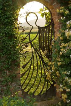 Birtsmorton Court, Worcestershire. The Angel gate in the walled garden looking over the Malvern hills made by Mike Roberts  Photo by Clive NIchols Garden Photography via FaceBook