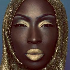 African model in a beautiful gold head wrap. Fashion.