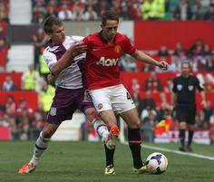 Adnan Januzaj shields the ball from Villa's Albrighton
