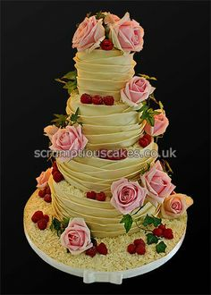 www.scrumptiouscakes.co.uk (757) - 4 tier white chocolate wrap wedding cake with fresh pink roses, ivy and raspberries.
