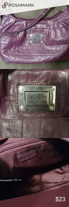 Perfect size NWOT Nicole Miller purse Gorgeous creamy eggplant color purse! Great size for daily use, 14x8. Several pockets inside keep you organized! Nicole Miller Bags Satchels
