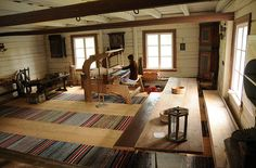 Weaving a rug. What a beautiful weaving studio...
