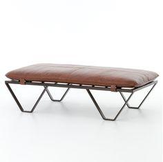 (https://www.zinhome.com/darrow-tan-leather-ottoman-with-geometric-metal-legs/)