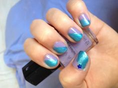 So i decided to paint my nails and wanted to go for the colour blocking effect. The Purple is Avon Nailwear Pro in the colour luxe lavender and the other colour is just a teal blue stripper nail pen. I used Sally Hansen double duty as a base and top coat, i swear by this top coat i use it all the time, then to finish it off i added a dark blue star gem in the corner of each thumb nail :D I enjoyed coming up with this design <3