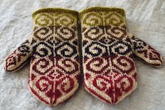 Stranded mittens with sore thumb and a traditional mitten shape, knit in decidedly non-traditional yarns, fibers, and colors.