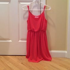 Lush silky coral dress in extra small! This dress is adorable for more formal occasions and looks great with either heels or flats. Only worn one to two times and it shows no signs of use! Lush Dresses