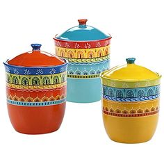Inspired by the bold colors of Spain, Certified International's Valencia Canister Set blends hand painted artistry with everyday dining. Crafted of ceramic, these bold and colorful pieces flaunt a charming design that enlivens your tablescape.