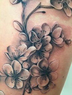 My cherry blossom tattoo in black and grey, on my left thigh.  Absolutely love it!