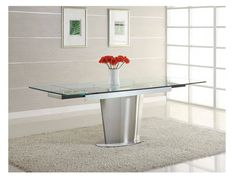 Check out our Adelaide Glass Table! Made with a stainless steel base and tempered glass top! Click on the image to find out more or visit www.modernsensefurniture.com