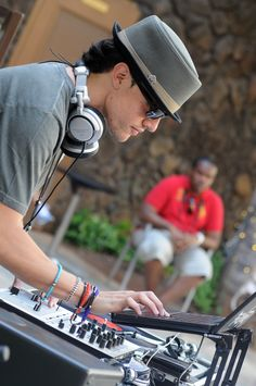 DJ in action at the Fasion Show at Royal Hawaiian Center, Waikiki, Hawaii
