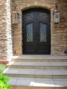 Mediterranean Design Front Entry ~ loving the great use of stone, unique door & lanterns