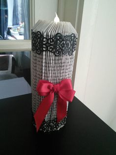 Folded book made into a candle stick hand decorated by Chillicraft