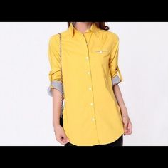 COTTON YELLOW BOTTON DOWN SHIRT WITH SIDE POCKETS Cotton botton down shirt with side pockets. Bust 98, length 71. Tops Button Down Shirts