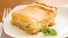 Orange Cream Dessert Squares--A sugar cookie crust with a hint of orange is the base for a creamy cheesecake filling. A sugar cookie crust with a hint of orange is the base for a creamy cheesecake filling. Just Desserts, Delicious Desserts, Dessert Recipes, Yummy Food, Bar Recipes, Appetizer Recipes, Yummy Treats, Sweet Treats, Orange Creme