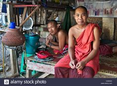 Download this stock image: Portrait of two Burmese monks on the streets of Yangon (Rangoon), Myanmar (Burma) - cn0n3g from Alamy's library of millions of high resolution stock photos, illustrations and vectors.