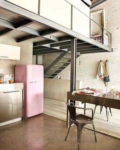 This lovely loft in Barcelona, Spain perfectly pairs modern industrial with inspired vintage design. This SMEG refrigerator, paired with brushed nickel accents, and soft creams allows this space to feel both modern and inviting. Pink Smeg Fridge, Retro Fridge, Vintage Fridge, Vintage Refrigerator, Vintage Kitchen, Kitchen Retro, Eclectic Kitchen, Refrigerator Freezer, Loft Estilo Industrial