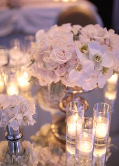 White Centerpieces // Photo: Esther Sun Photography // TheKnot.com