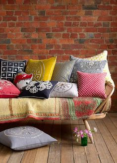 Interesting assorted cushions for sofa with brick wall effect for wooden floor plus beautiful flower avse in front of sofa design idea Ikea Sofas, Designer Couch, Deco Boheme, Interior Decorating, Interior Design, Sofa Design, Pillow Design, Interior Ideas, The Design Files
