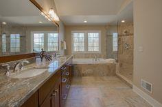 Granite countertops. Large soaking tub and custom ceramic and glass shower. Ceramic tile floors. Maple cabinets.