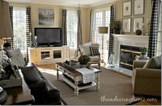family room ...love these curtains and the tv console, and the furniture.