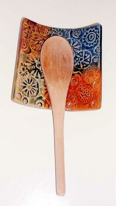 Spoon Rest only $12; or similar pottery spoon rest.