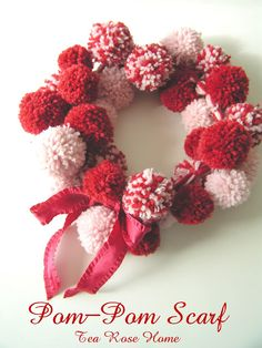 Tea Rose Home: Tutorial ~ Pom-Pom Scarf. I think it would look better as a decorative wreath.