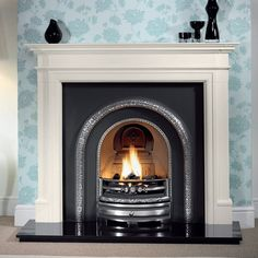 The Gallery Bartello Limestone Fireplace with Lytton Cast Iron Arched Insert consists of the Bartello Agean limestone mantel and Lytton cast iron arched insert with cast back. There are extensive hearth options available alongside an optional gas f Granite Hearth, Slate Hearth, Fireplace Stores, Stove Fireplace, Fireplace Ideas, Fireplace Mantles, Cast Iron Fireplace Insert, Fireplace Inserts, Wooden Fire Surrounds
